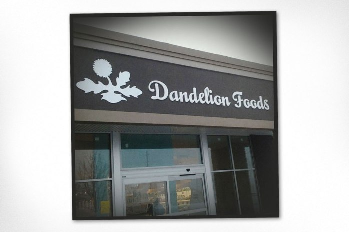 Outdoor signage designed for local health food store. A revised logo was developed for this application to allow for no type inside dandelion shape. Logo was also designed at Sumack Loft.