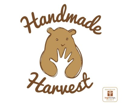 "Concept created in 2014 for the Handmade Harvest Craft Show, this logo was selected by a panel of judges in 2017 from over 40,000 entries to be featured in LogoLounge Volume 10, an annual ""best of the best"" book of logo design. The logo features a bear clutching a harvested bundle of items in its arms that upon second glance resembles a human hand. I always loved this design although the client chose another favourite. The craft show has since undergone a name change, and a new identity subsequently developed, however I still think the designs I created at the time stand out as some of my best work."